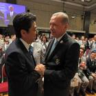 The finalists: Prime Minister Shinzo Abe is congratulated by Turkish Prime Minister Recep Tayyip Erdogan after IOC President Jacques Rogge announced on Saturday in Buenos Aires that Tokyo will host the 2020 Summer Olympics.