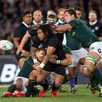 Back in black: New Zealand's Ma'a Nonu (front) passes the ball during the All Blacks' 29-15 win over South Africa at Auckland's Eden Park on Saturday. | AFP-JIJI