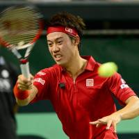 Baseline blast: Kei Nishikori plays a shot during his 6-3, 6-4, 6-4 win over Alejandro Falla in the opening match of Japan's Davis Cup World Group playoff against Colombia on Friday. | AFP-JIJI