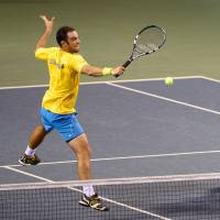 Team spirit: Colombia's Juan Sebastian Cabal (left) returns a shot as doubles partner Robert Farah looks on in their 6-1, 6-2, 6-1 win over Tatsuma Ito and Yuichi Sugita on Saturday. | AFP-JIJI