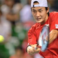 World in motion: Go Soeda plays a shot during his match against Alejandro Falla during Japan's Davis Cup World Group playoff against Colombia on Sunday. Japan won 3-2. | AFP-JIJI