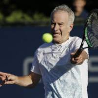 Helping hand: Tennis legend John McEnroe will take on Kei Nishikori in a charity match at Ariake Colosseum on Nov. 17. | AP