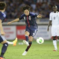 On target: Japan's Yasuhito Endo scores a go-ahead goal in the 64th minute against Ghana on Tuesday at Nissan Stadium in Yokohama. Japan beat Ghana 3-1 in an international friendly. | KYODO