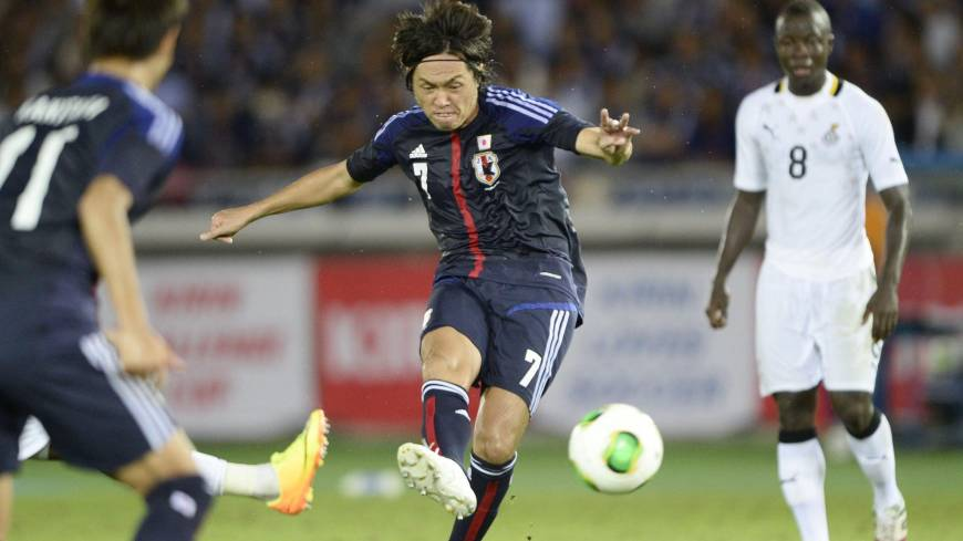 On target: Japan's Yasuhito Endo scores a go-ahead goal in the 64th minute against Ghana on Tuesday at Nissan Stadium in Yokohama. Japan beat Ghana 3-1 in an international friendly.