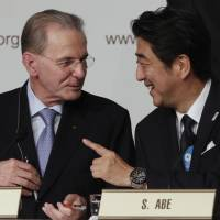 The happiest of times: Prime Minister Shinzo Abe greets IOC President Jacques Rogge after Tokyo was awarded the 2020 Summer Olympics on Saturday in Buenos Aires.  | AP