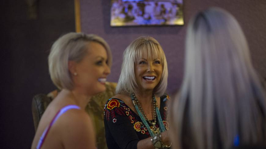 Ladies of the night: Susan Austin (center), the madam for the Mustang Ranch, talks with sex workers Jaylynn Jones (left) and Amaris inside the brothel in Sparks, Nevada, last month.