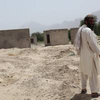Few winners in Afghan village flattened by U.S.