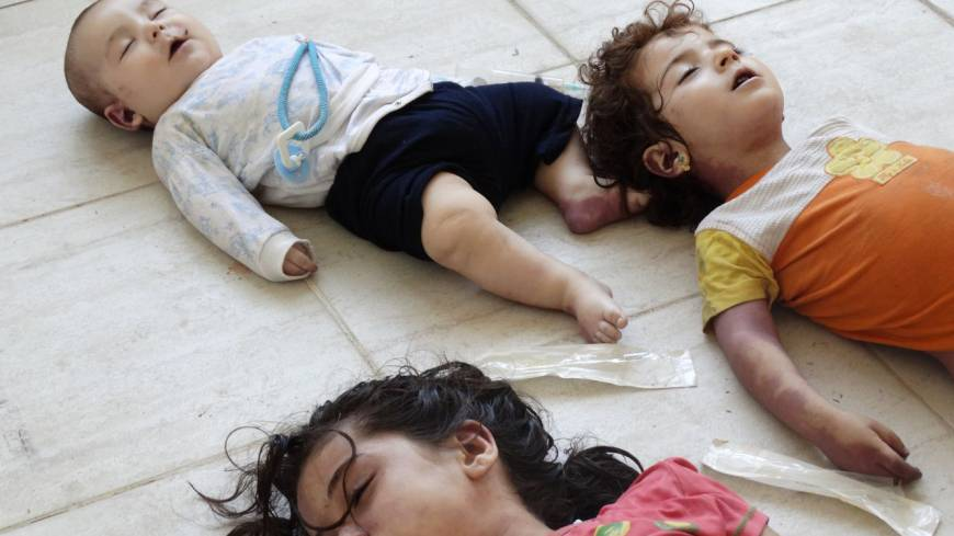 Tiny casualties: The bodies of a baby and two children, victims of a purported chemical weapons attack on Ghouta, Syria, are seen on Aug. 21.
