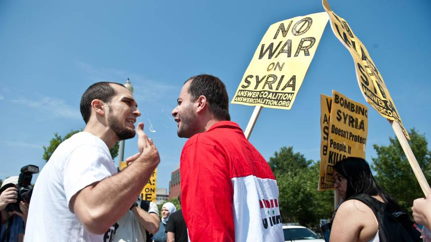 War of words: Protesters argue during demonstrations for and against a U.S.-led strike on Syria in front of the White House in Washington on Saturday.