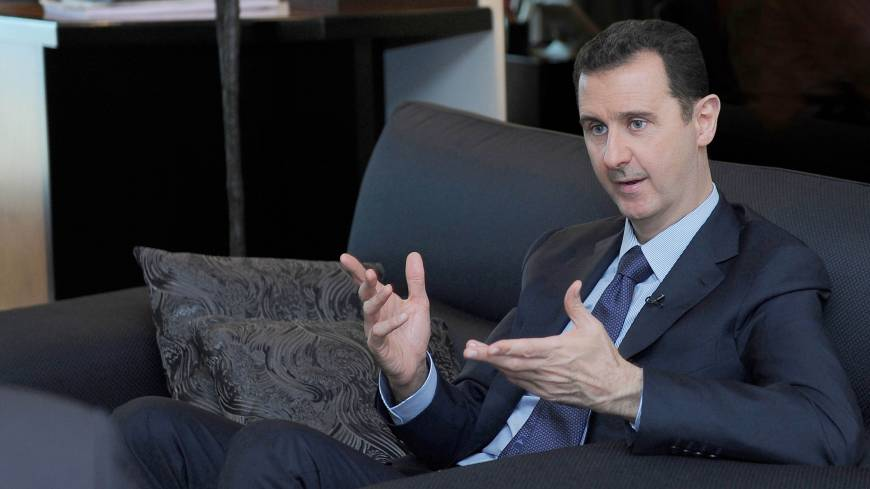 Regime commander: Syrian President Bashar Assad speaks during a recent interview with a Russian newspaper in Damascus.