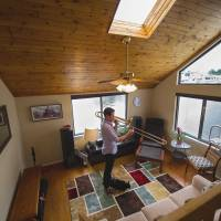 Water music: David Murray, a trombonist with Washington's National Symphony Orchestra, practices in his houseboat, which features large windows and skylights. The houseboat is docked at the Gangplank Marina in the U.S. capital. | THE WASHINGTON POST