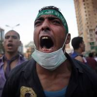 Rebel yell: Supporters of Egypt's ousted president, Mohammed Morsi, chant slogans during a protest in Cairo on Friday. | AP