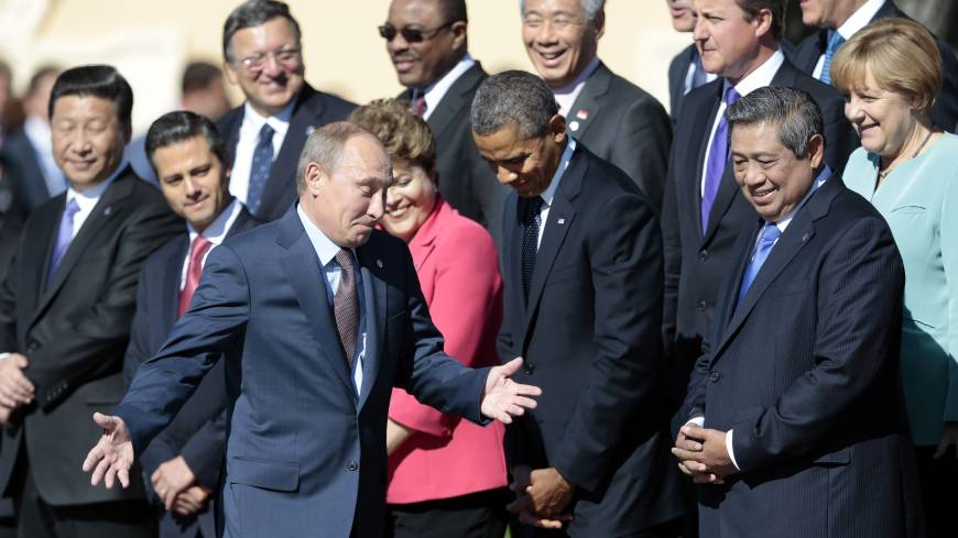 Face to face: Russian President Vladimir Putin (center foreground) shrugs as he walks by U.S. President Barack Obama (front, second right) during a group photo outside of the Konstantin Palace in St. Petersburg, Russia, on Friday.