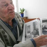 The banality of evil: Rochus Misch, one of Adolf Hitler's bodyguards, points to a picture of the Nazi leader he took in the early 1940s in Berchtesgarden, southern Germany, at his home in Berlin in March 2005. | AP