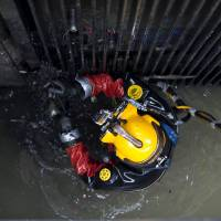 Groping in the dark: Diver Julio Cesar Cu prepares to be lowered into garbage at one of Mexico City's sewage plants in August.   AFP-JIJI    | AFP-JIJI