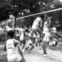 Fast paced: Members of Washington's Chinese Youth Club play 9-man volleyball in Washington in 1952. This version, usually played on city streets with rules stressing players' Chinese heritage, draws hundreds to tournaments. | COURTESY OF THE CHINESE YOUTH CLUB