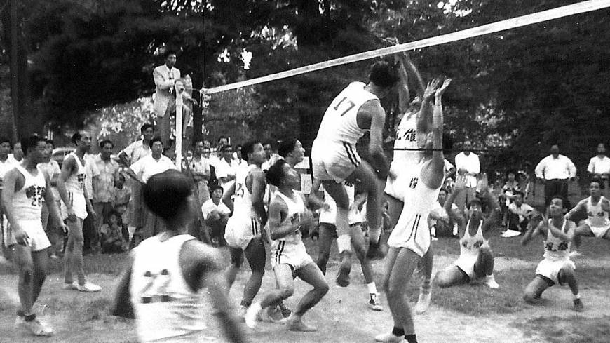 Fast paced: Members of Washington's Chinese Youth Club play 9-man volleyball in Washington in 1952. This version, usually played on city streets with rules stressing players' Chinese heritage, draws hundreds to tournaments.