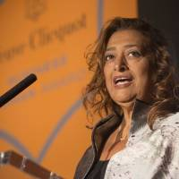'A planet in her own inimitable orbit': Architect Zaha Hadid gives a speech after  receiving the  Veuve Clicquot Business Woman Award 2013 in April. | BLOOMBERG