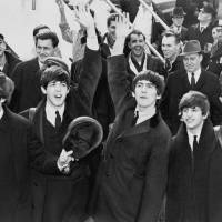 Popping in: The Beatles wave after arriving at New York's Kennedy International Airport in February 1964. U.S. | LIBRARY OF CONGRESS