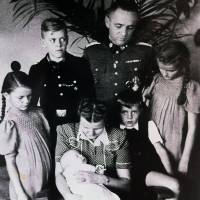 Family ties: Rudolf Hoss, the commandant of Auschwitz, poses for a photo with his family at their villa on the grounds of the concentration camp in 1943. Counterclockwise from left are: Inge-Brigitt (Brigitte), Hedwig holding Annegret, Hans Jurgen, Heidetraud, Rudolf and Klaus. | THE WASHINGTON POST