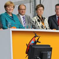 Strong Merkel starts final vote drive wary of allies' weaknesses