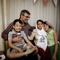 Home free: Iranian lawyer Nasrin Sotoudeh poses with her family at home in Tehran on Wednesday after being released following three years in prison. | AFP-JIJI