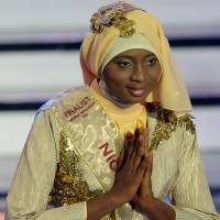 Burqas before bikinis: Obabiyi Aishah Ajibola of Nigeria wins the Muslimah World contest Wednesday in Jakarta. | AFP-JIJI