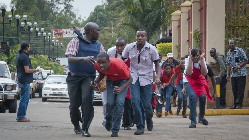 Civilians flee from Westgate Mall after police exchange gunfire with militants in Nairobi on Saturday.