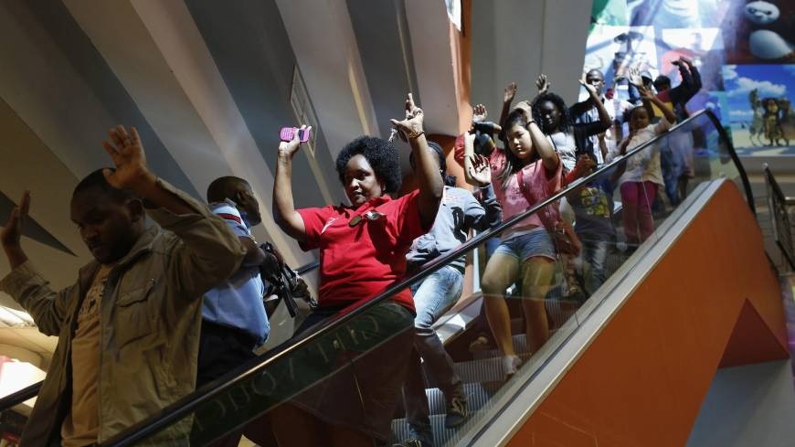 Lucky escape: Civilians escape from Westgate shopping mall in Nairobi on Saturday.