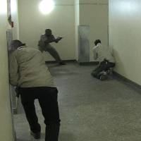 Kenyan security forces search inside the mall for remaining gunmen on Saturday. | AFP-JIJI