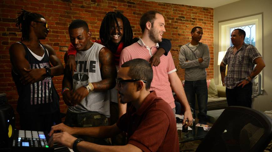 Making music: Producer and manager Miguel Pena (foreground) takes care of the sound mixing for rappers Pacman (third from left) and Peso (left) during a Sept. 12 rehearsal and recording session at the Washington home of Ramsey Aburdene (third from right). Also shown are Josh Wiley (second from right), Michael Bassett (right) and Domo Bang (second from left). Pacman and Peso plan to travel to North Korea to make a rap video.