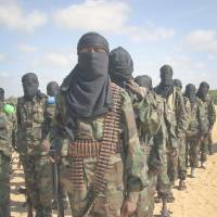 Brothers in arms: Al-Shabab members attend a rally on the outskirts of Mogadishu in February 2012 after al-Qaida announced a tie-up with the Somalian militant group. | AP