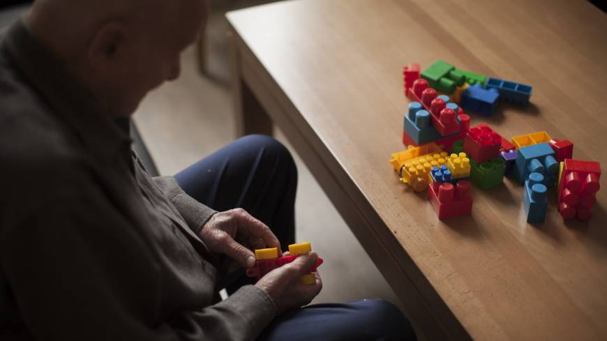New life: An elderly resident sits at a table and plays with colored building blocks at the nursing home where he lives in Szklarska Poreba, Poland, on Aug. 24.