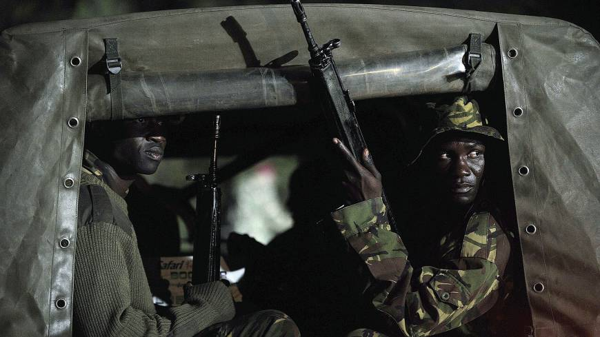 Reinforcements: Kenyan paramilitary troops drive toward the Westgate Premier Shopping Mall in Nairobi on Tuesday.