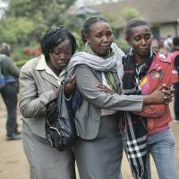 Family tragedy: Relatives of Johnny Mutinda Musango, 48, weep after identifying his body at the morgue in Nairobi on Tuesday. Musango was one of the victims of the  Westgate Mall hostage siege. | AP