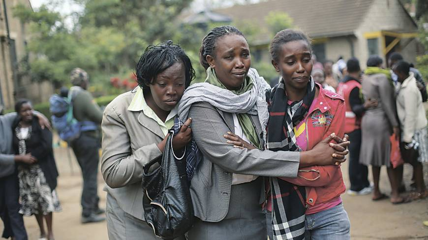 Family tragedy: Relatives of Johnny Mutinda Musango, 48, weep after identifying his body at the morgue in Nairobi on Tuesday. Musango was one of the victims of the  Westgate Mall hostage siege.