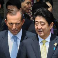 'Constant offender': Australian Prime Minister Tony Abbott stands next to Prime Minister Shinzo Abe during a photo shoot of the leaders at the Asia-Pacific Economic Cooperation summit in Nusa Dua, on the Indonesian resort island of Bali, on Tuesday. | AFP-JIJI