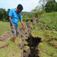 Instant landscaping: The crack stretches for several kilometers through farmland. | AFP-JIJI