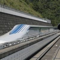 All aboard:  The L0 (L-zero) series magnetic-levitation train, developed by Central Japan Railway Co., sits parked on a test track at the control center before a trial run in Tsuru, Yamanashi Prefecture, in August. | BLOOMBERG