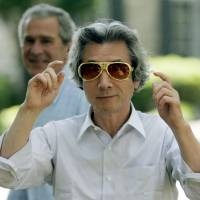 Bright future: Then-Prime Minister Junichiro Koizumi puts on Elvis-style shades after being taken on a tour of Graceland, the Memphis, Tennessee, home of Elvis Presley, by U.S. President George W. Bush in 2006. | AP
