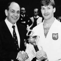 Paul Martin cares for swords kept at the British Museum. Right: Martin is crowned the 1993 English karate champion in the lightweight division, a title he held three times. | COURTESY OF PAUL MARTIN