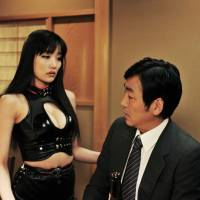 Getting started: Playing a dominatrix in director Hitoshi Matsumoto's 'R100,' Erika Sato eyes a client — the film's star, Nao Omori. | ©YOSHIMOTOKOUGYOU KABUSHIKIGAISHA