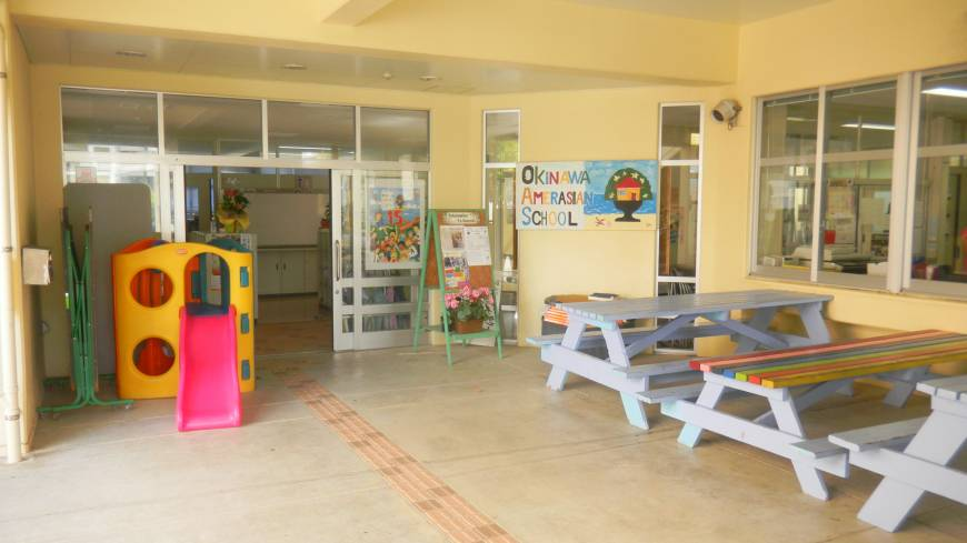 Doors open: The outside of the AmerAsian School in Okinawa, which is located in Ginowan City.