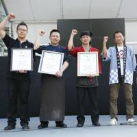 Men of taste: The winners of last year's Ikemen Battle show off their certificates.