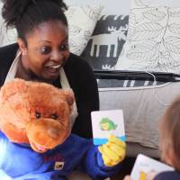 Body talk: Shana Segawa and her puppet bear Beebo encourage a young student to communicate through sign language. | DANIELLE DEMETRIOU