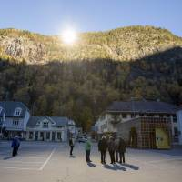 Sunrise: Three giant mirrors erected on the mountainside above Rjukan, Norway, reflect sunshine toward the center of the town below. | AFP-JIJI