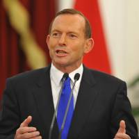 Seeking progress: Australian Prime Minister Tony Abbott faces reporters Monday during a joint statement with Indonesian President Susilo Bambang Yudhoyono at the presidential palace in Jakarta. | AFP-JIJI