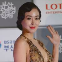 Reeling them in: South Korean actress Han Soo-ah arrives for the opening ceremony of the 18th Busan International Film Festival on Thursday. |  AFP-JIJI