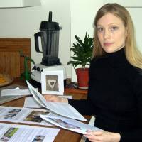 Crusader: Marianne Bailey holds copies of documents she submitted to Britain's Home Office at her London home Oct. 2. Bailey is leading a campaign against new immigration rules that could prevent some Britons from living in the country with their foreign partners. | KYODO