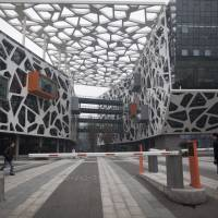 Journey of 1,000 miles: Workers enter Alibaba.com Ltd.'s headquarters in Hangzhou, China.   BLOOMBERG